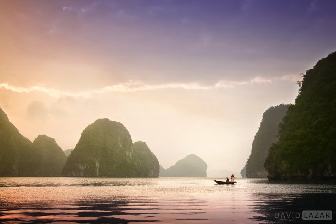 Purple sunsrise fishermen on Ha Long Bay, Vietnam