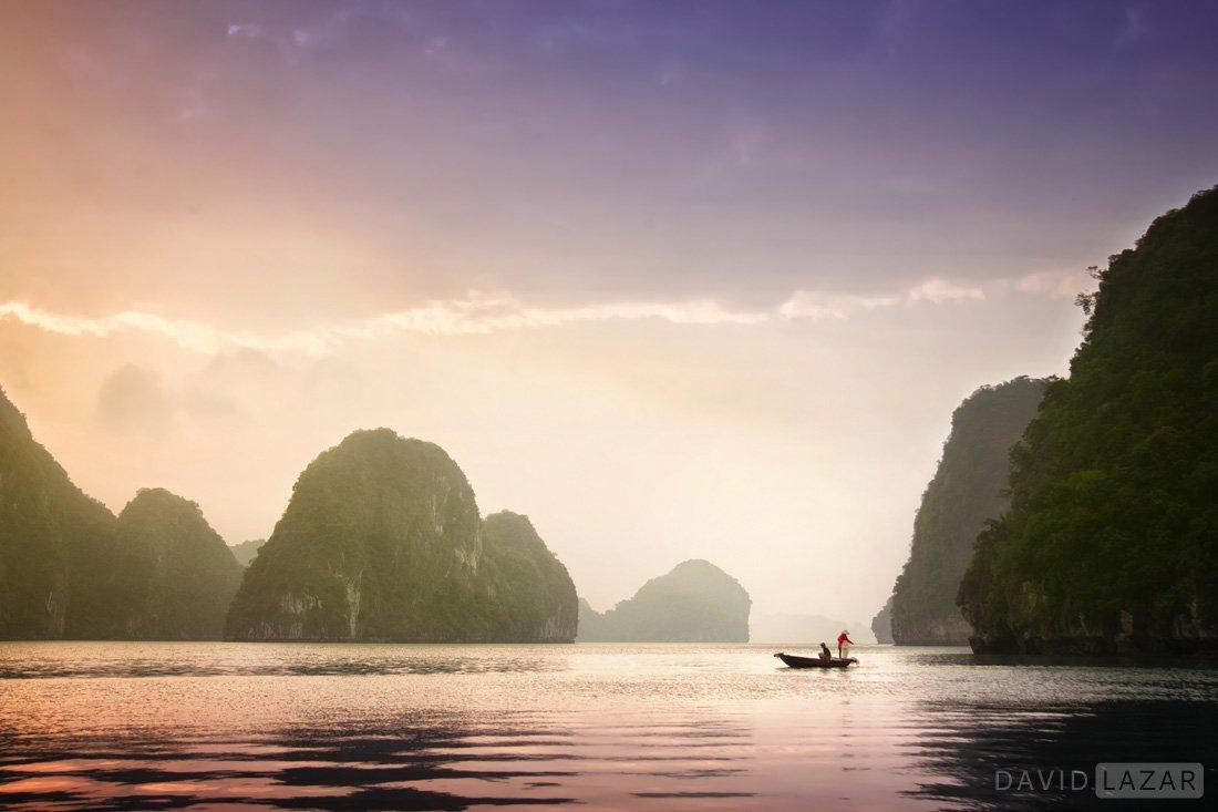 Purple sunsrise fishermen on Ha Long Bay, Vietnam