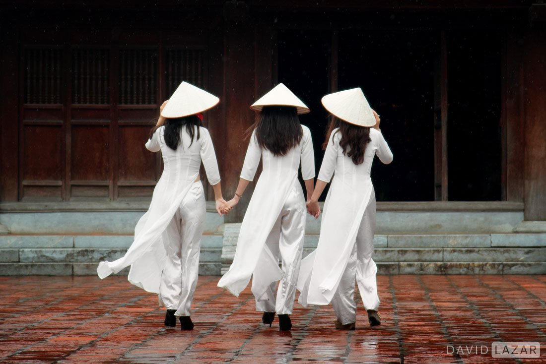 Beautiful girl in ao dai outside at Temple of Literature in Hanoi, on Vietnam photo tour