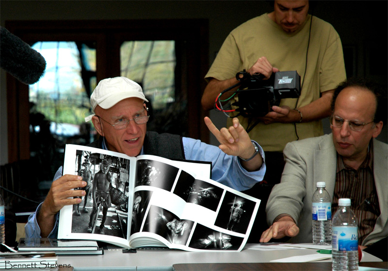 Salgado speaking at a workshop with photographer Bennett Stevens