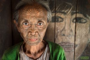 Chin woman with face tattoo near Mrauk U, Myanmar