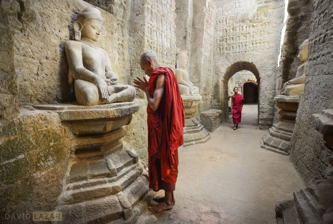 Monks inside Kauthaung temple in the lost city of Mrauk U, Myanmar