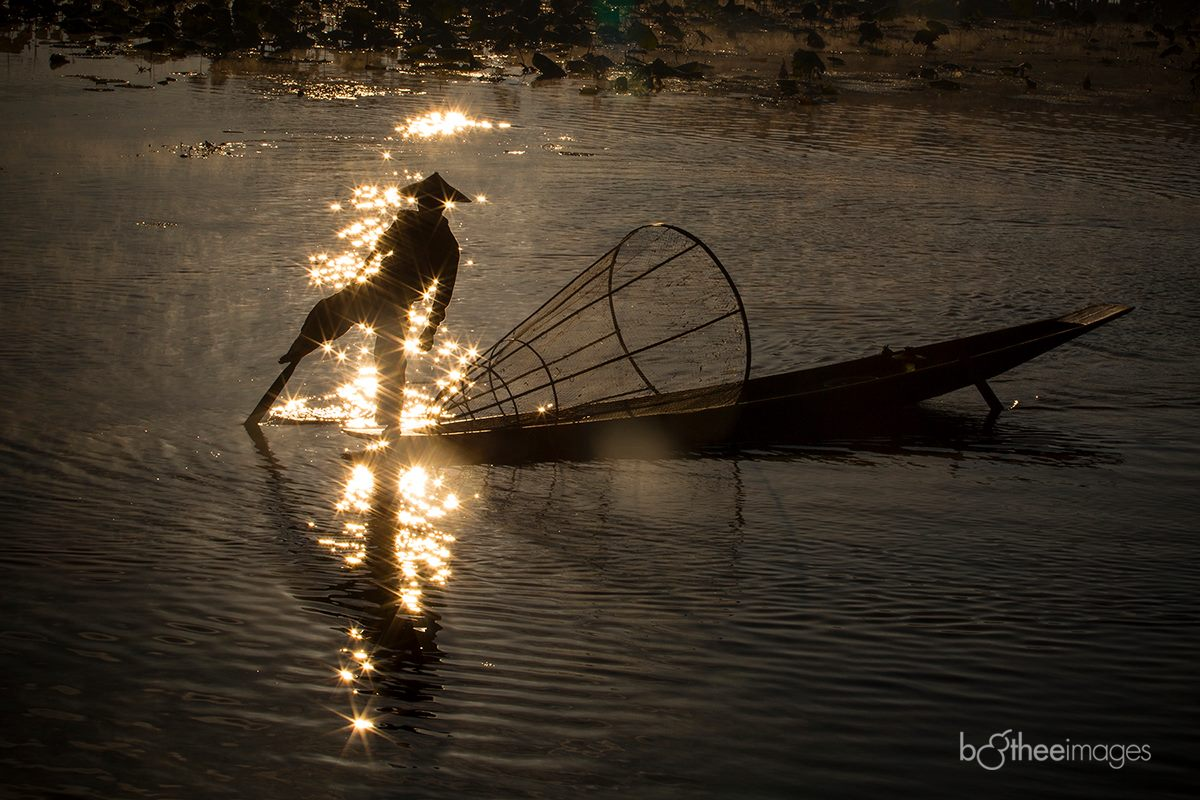Sunset on Inle Lake with Intha fisherman