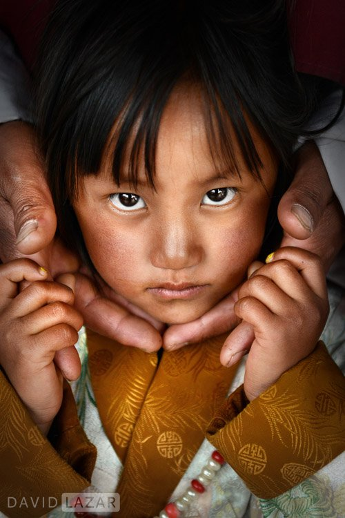 Lovely little girl dressed up for festival in Bhutan
