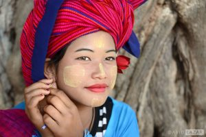 Classic travel portrait of a girl in Myanmar wearing Thanaka paste