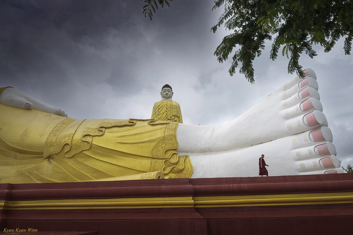 Monk and giant Buddhas in Burma