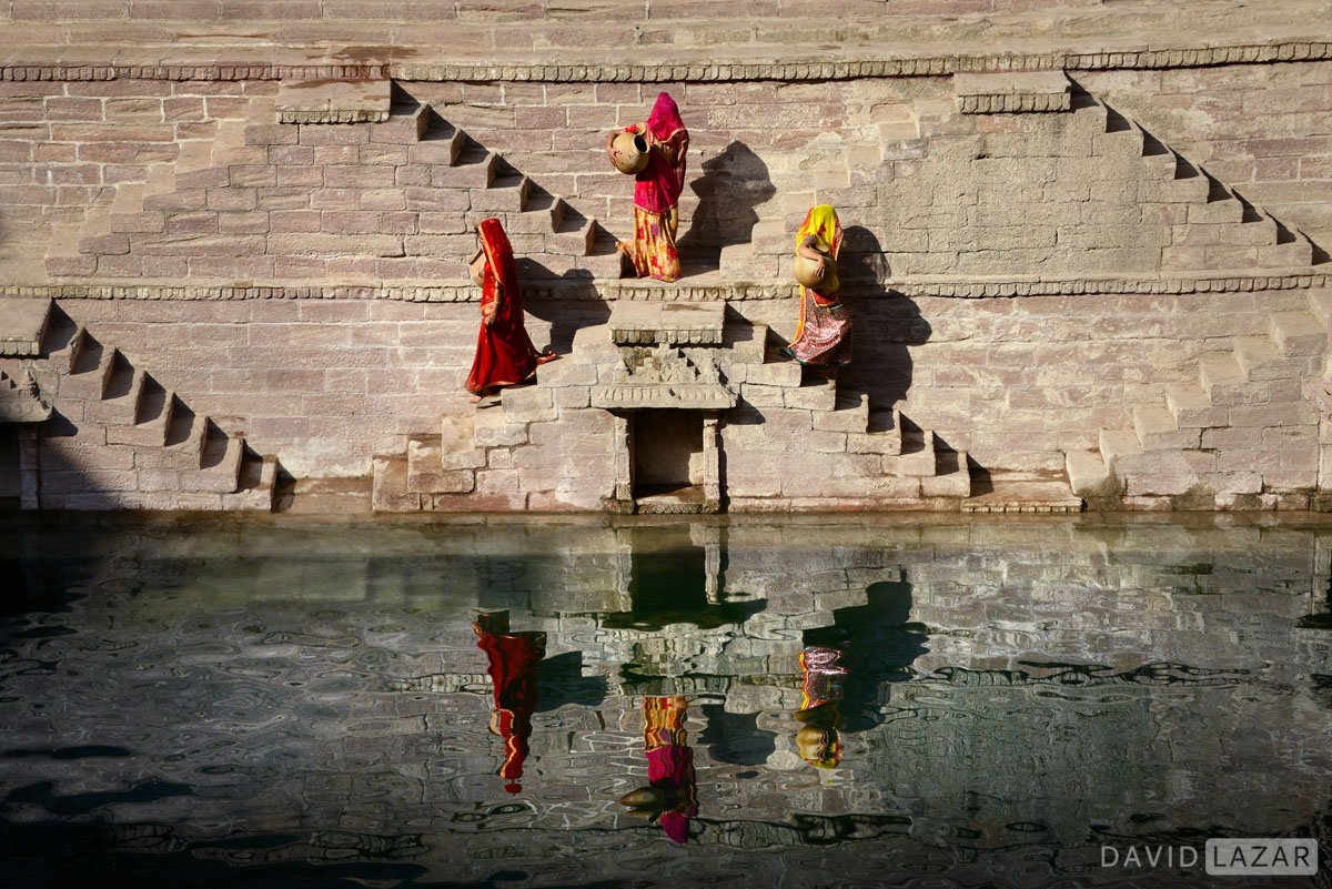 Stepwell with ladies in saris on India photo tour with Luminous Journeys