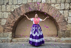 Sina-Falker_alt=Oaxaca woman tossing flowers on Mexico photo tour