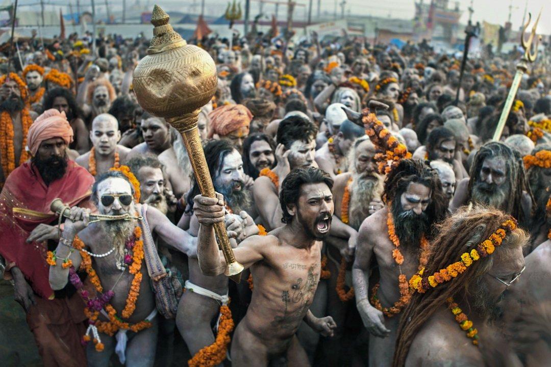 Naga warrior ascetics charge the bathing area at the 2029 Kumbh Mela in India
