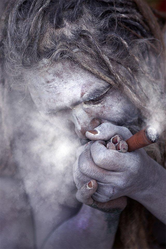 Photographing Kumbh Mela naga smoking ganga