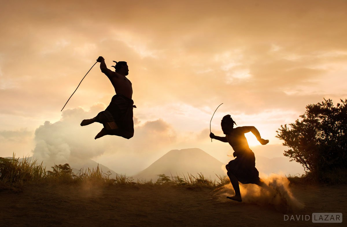 Tengger-tribesmen-stick-fighting-with-Mt.-Bromo-in-background