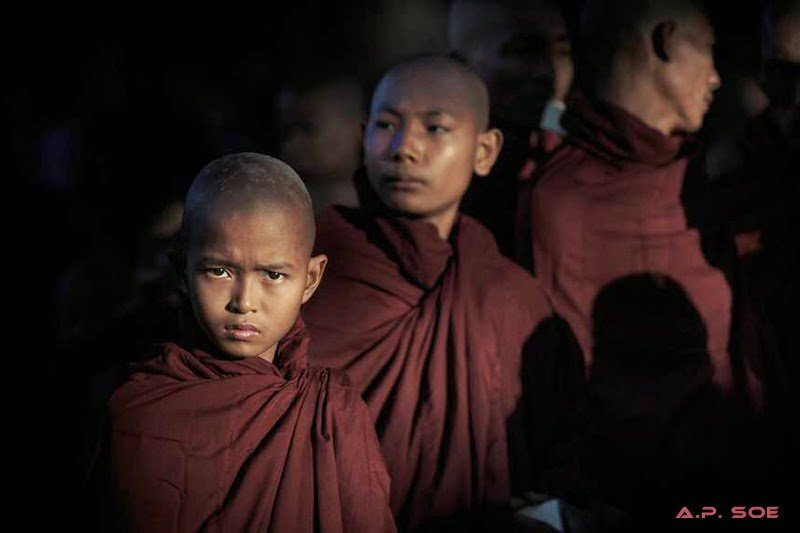 Novice monks at sunrise taken on Burma photo tour