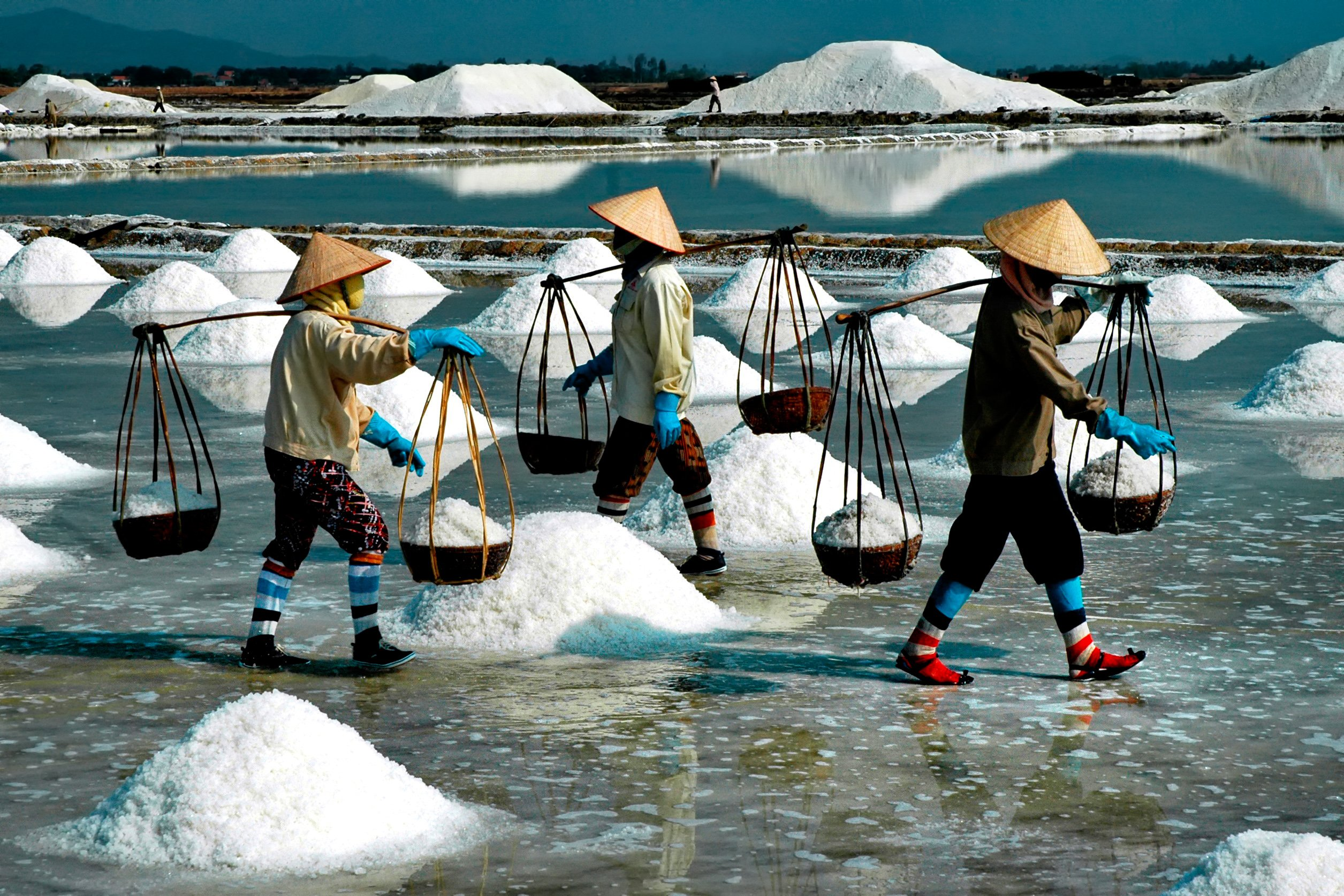 Salt pond workers in Khanh Hoa, taken on Vietnam photo tour