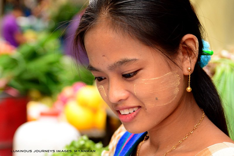 Girl in Chinatown morning market as a Myanmar photo tour workshop takes place