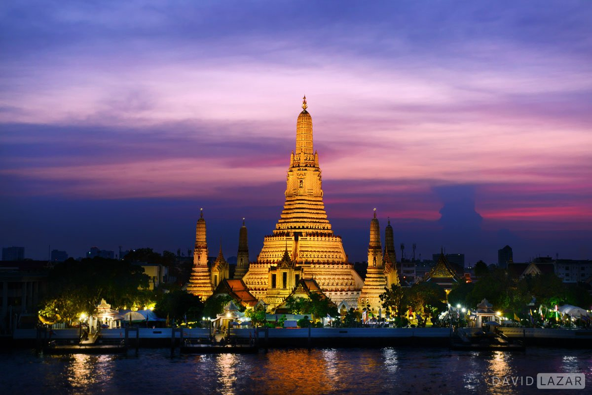 Wat Arun on the Chao Phraya River durin blue hour.