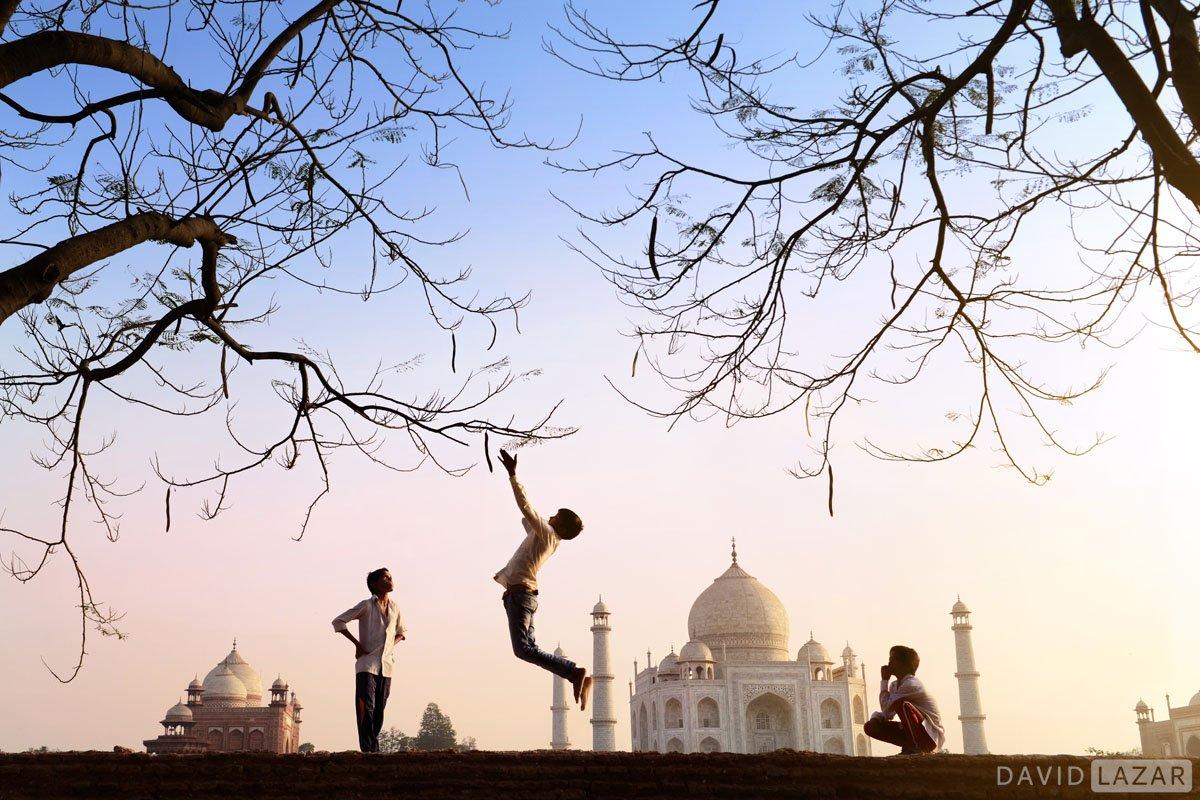 Boy jumping near Taj Mahal