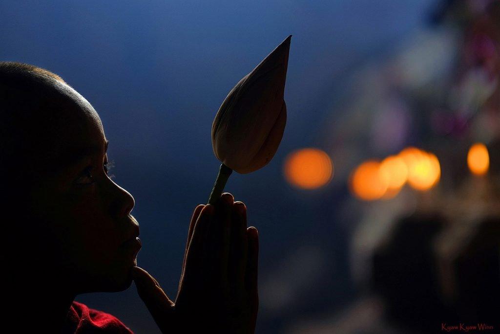 Novice monk in Myanmar in a low light portrait by Kyaw Kyaw Winn