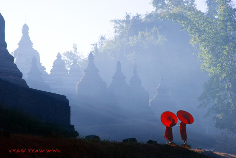 Cover shot of monks and umbrellas in Mrauk U, Myanmar