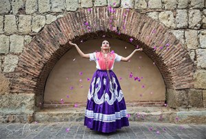 Sina-Falker_altOaxaca-woman-tossing-flowers-on-Mexico-homebanner