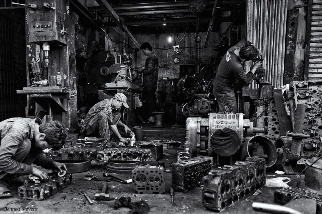 Machine shop men in Phnom Penh on Cambodia photo tour