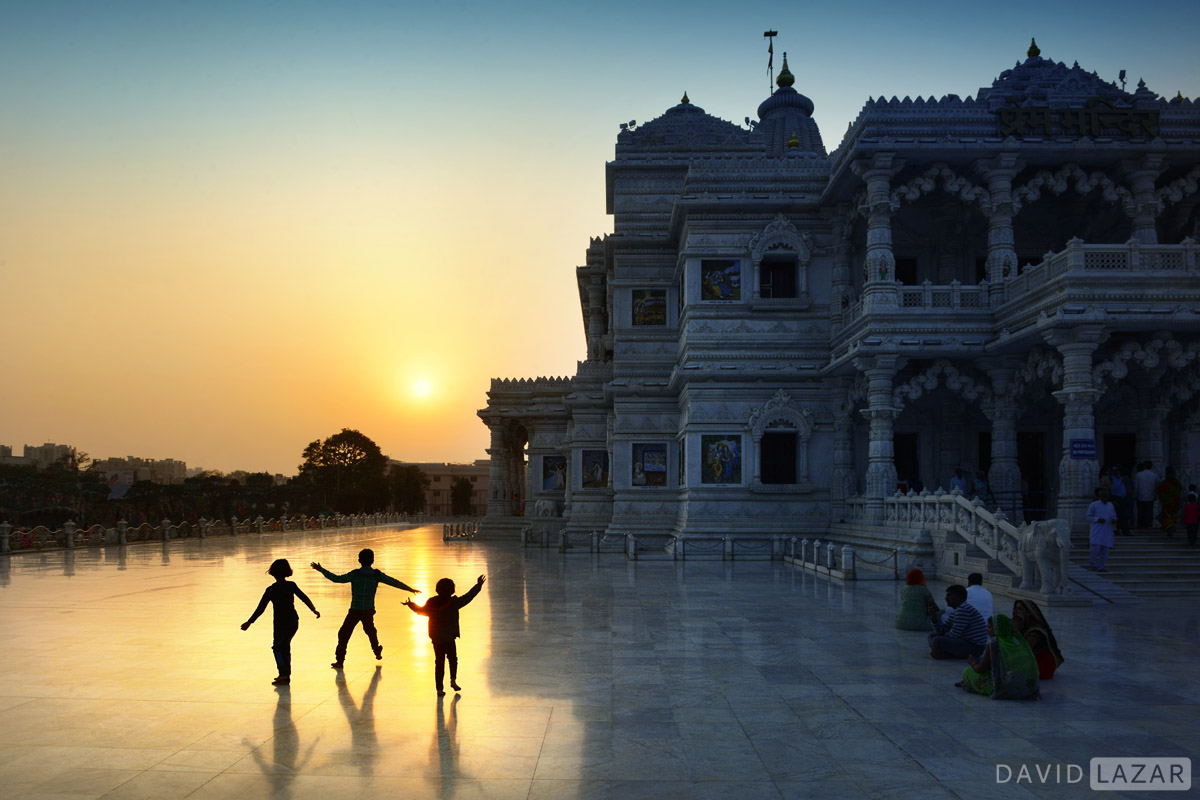 Candid scene at Vrindavan with kids at sunset temple
