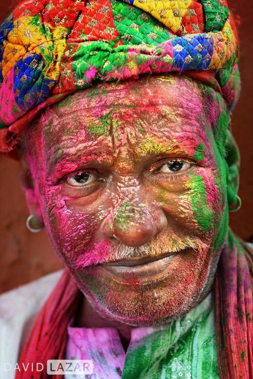 Man covered on Holi powder, India