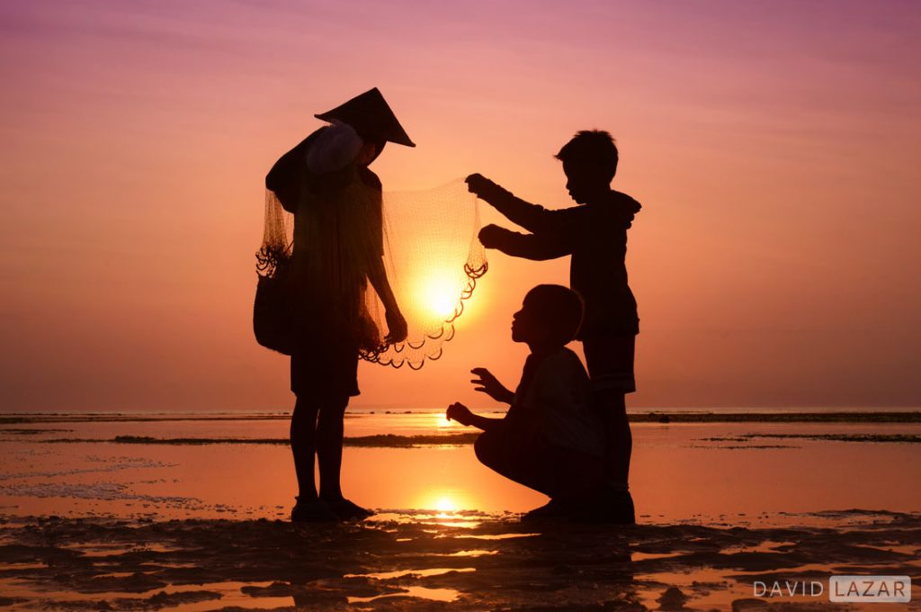 Sunrise at Sanur with fisherman and kids, taken on Bali photo tour workshop