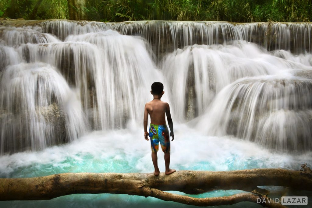 Boy at waterfalls in Laos
